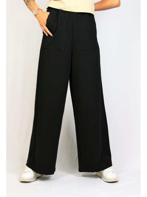 Широк панталон с външни джобове